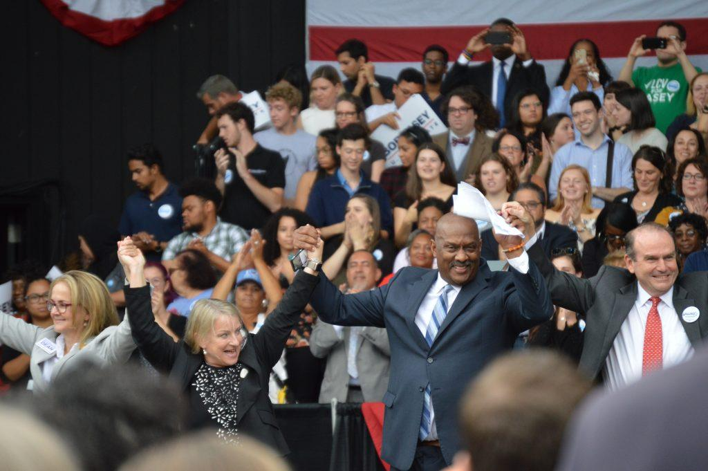 [left to right] Madeleine Dean, Susan Wild, Congressman Dwight Evans, and *unknown Democrat federal congressional candidate* rally up the crowd. Staff Photographer Hannah Woodruff