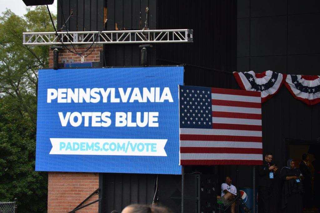 "One of many campaign boards with the event's slogan, ""Pennsylvania Votes Blue."" Staff Photographer Hannah Woodruff"