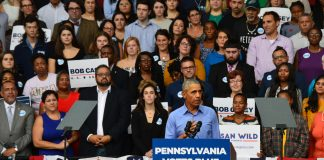 Former President Barack Obama makes a guest appearance and encourages the crowd to vote this November. Staff Photographer Hannah Woodruff