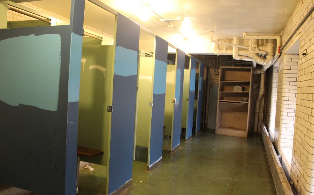 Discolored stalls in the girls locker room. Staff Photographer Bwe Ku.