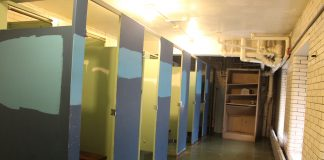 Discolored stalls in the girls locker room. Staff Photographer Bwe Ku.
