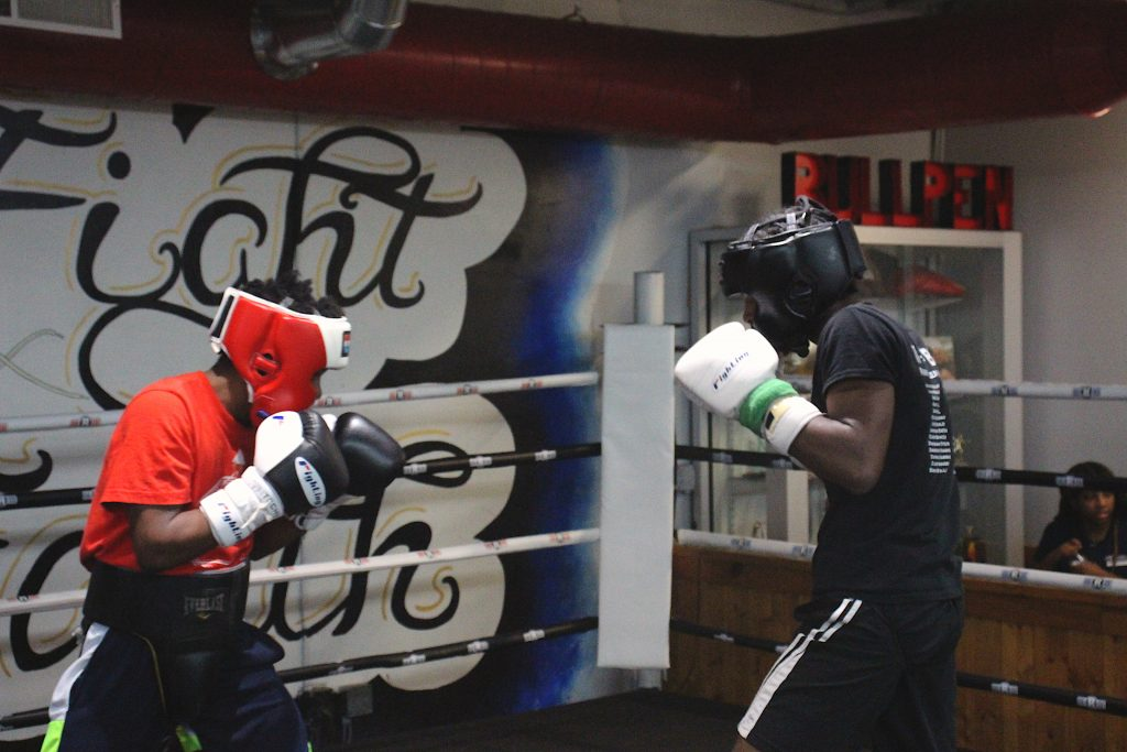 Boxer and FLC Alumni, Aanjhrue Williams, (right) spars at Rock Ministries Boxing Gym on October 10. · Sandraliz Flores / STAFF