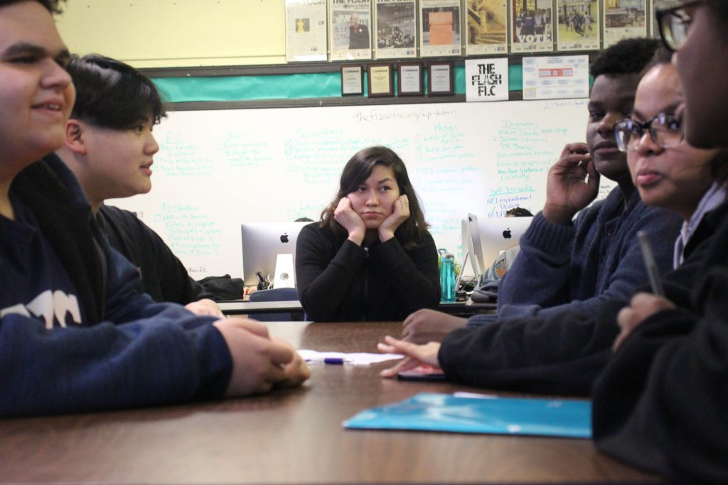 NLA senior Rosario Lemus sits excluded from the classroom discussion.