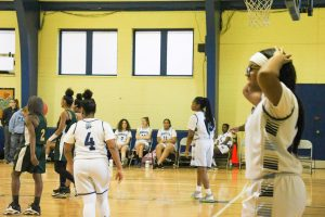 The Bobcats Girls Varsity Basketball Team Captain, FLC junior, Ericka Porterfield, frustrated after one of the girls from Edison High ́s basketball team stole the ball.